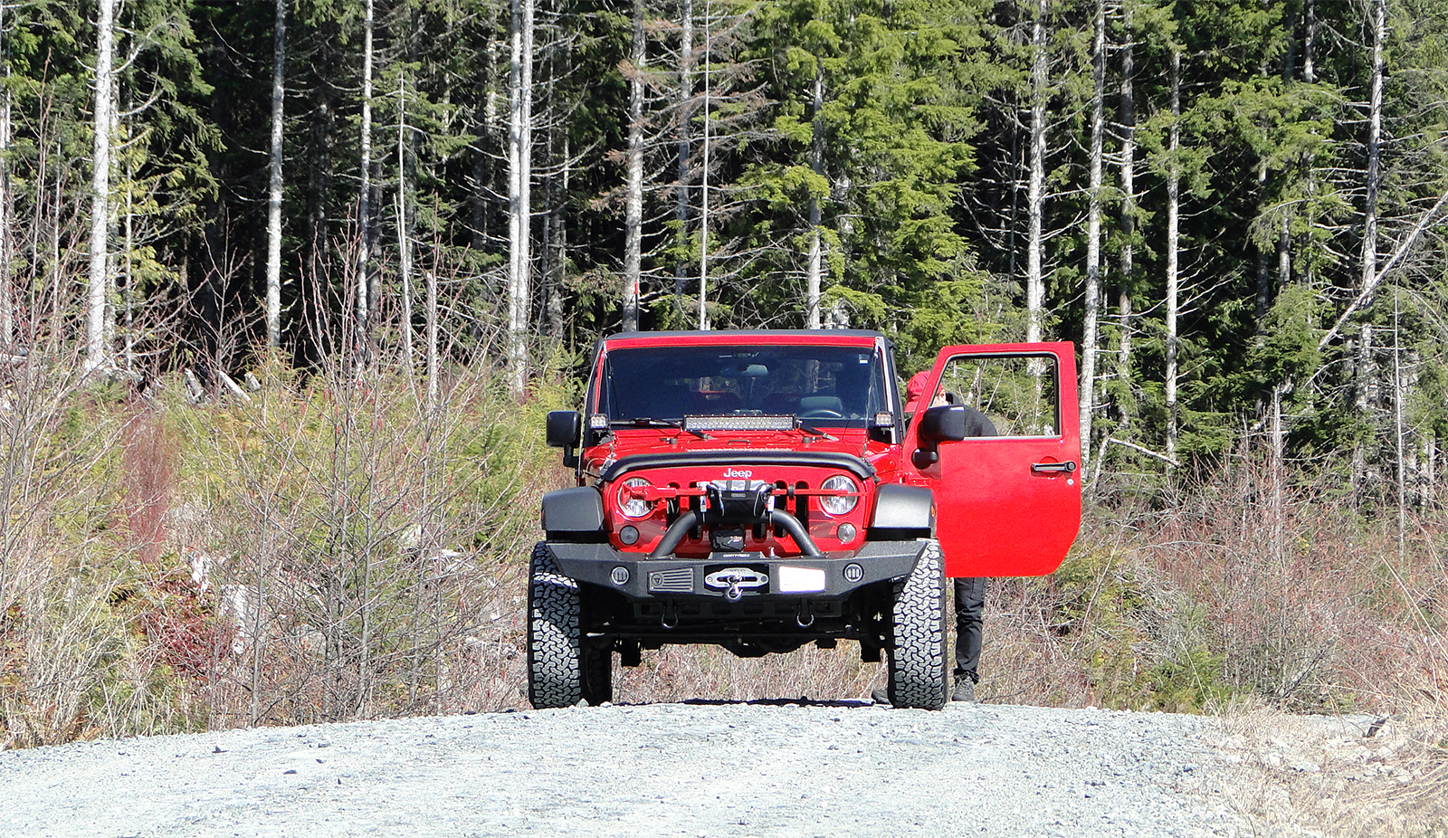 A Light Red Jeep Solo Expedition British Columbia